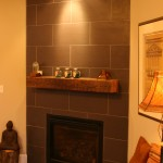 Re-tiled Fireplace and Salvaged Beam Mantle